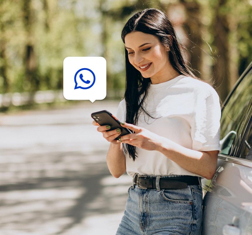 Girl using Whatsapp on her mobile phone